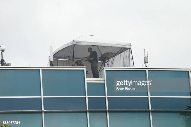Police on a nearby rooftop monitor the scene at the site of a planned speech by white nationalist Richard Spencer who popularized the term 'altright'...