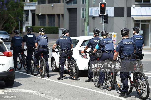 Police on bicycles patrol the streets ahead of the G20 Summit in Brisbane on November 13 2014 Brisbane will host the G20 Leadership Summit on...