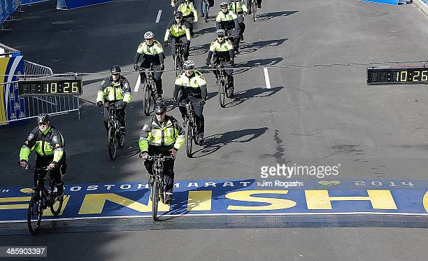 Police on bicycles ride the route before the start of the 2014 BAA Boston Marathon on April 21 2014 in Boston Massachusetts