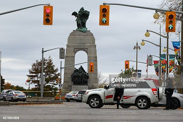 Police on guard near the National War Memorial in Ottawa Canada on October 22 2014 Gunfire echoed through the Gothic halls of the Canadian parliament...