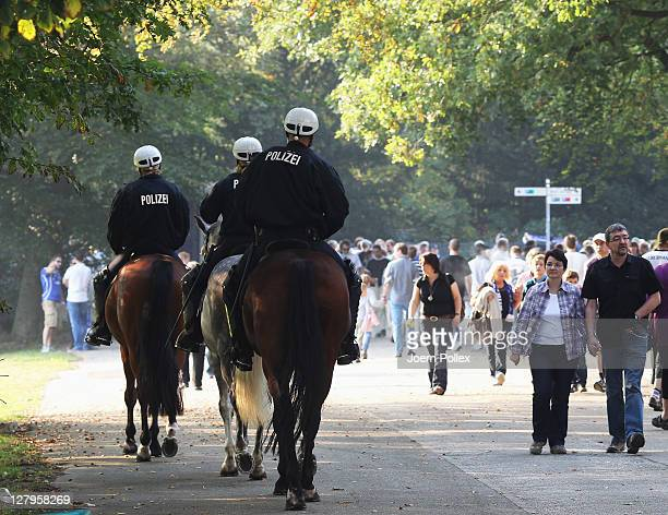 Police on horses are seen at the Arena prior to the start of the Bundesliga match between Hamburger SV and FC Schalke 04 at Imtech Arena on October 2...