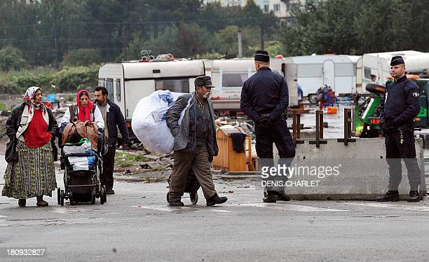 Police on September 18 2013 watch the final operation evacuating the largest Roma encampment in the Lille area The last caravans of the illegal...