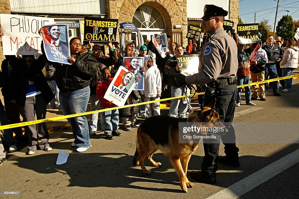 Police order demonstrators back while they chant in support of Democratic presidential nominee Sen Barack Obama outside a rally for Republican...