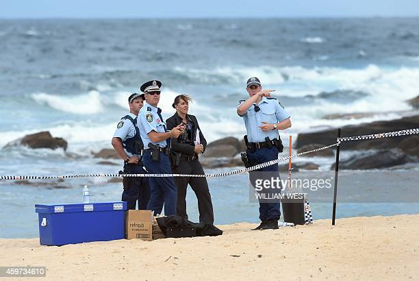 Police organise a search of the sand dunes after children playing at a Sydney beach on November 30 stumbled across the body of a baby buried under...