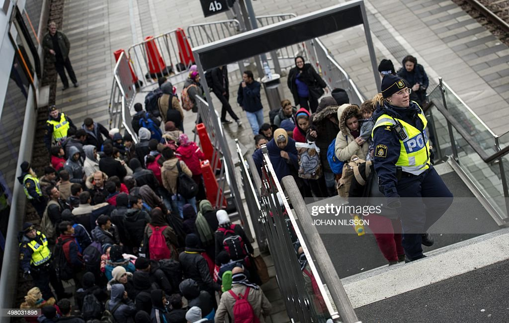 Police organize the line of refugees on the stairway leading up from the trains arriving from Denmark at the Hyllie train station outside Malmo, Sweden, November 19, 2015. 600 refugees arrived in Malmo within 3 hours and the Swedish Migration Agency said in a press statement that they no longer can guarantee accommodation for all asylum seekers.