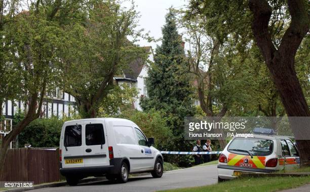 Police outside a house on a private estate in Highgate Hill Hampstead north London where the bodies of an elderly couple were found after being...
