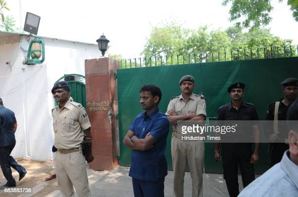 Police outside RJD Chief Lalu Prasad's residence during income tax raid on May 16 2017 in Patna India The Income Tax Department carried out raids at...