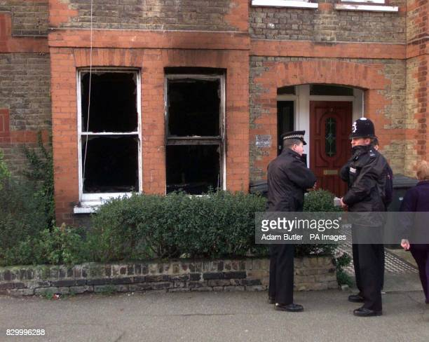 Police outside the burnt out house in Catford south east London where a 18 month old baby girl with stab wounds was found being cradled on the...
