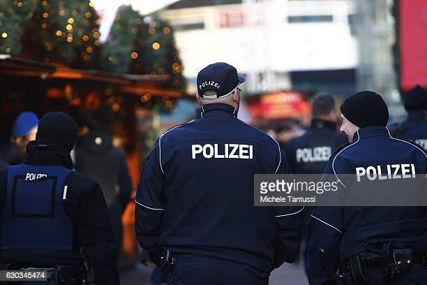 Police patrol a Christmas market at the Alexanderplatz the day it reopened following an apparent terror attack on another Christmas market in the...