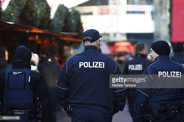 Police patrol a Christmas market the day it reopened following an apparent terror attack on another Christmas market in the city center on December...