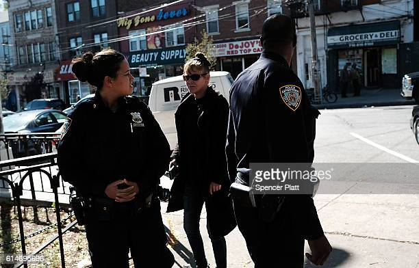 Police patrol a park in a neighborhood with a high rate of poverty and illegal drug use on October 14 2016 in New York City Staten Island a New York...