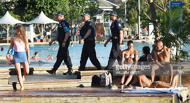 Police patrol amongst swimmers at the Southbank precent where the G20 Leader's Summit will be held in Brisbane on November 14 2014 Australia hosts...