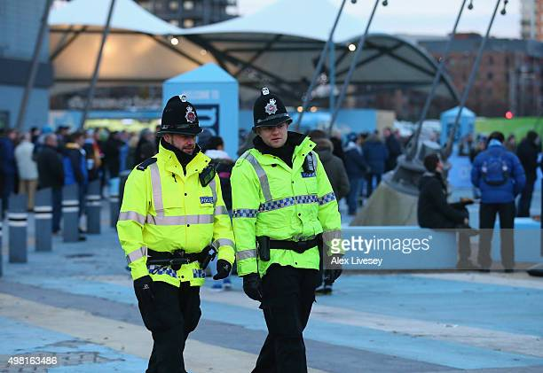 Police patrol around the Etihad Stadium prior to the Barclays Premier League match between Manchester City and Liverpool at Etihad Stadium on...