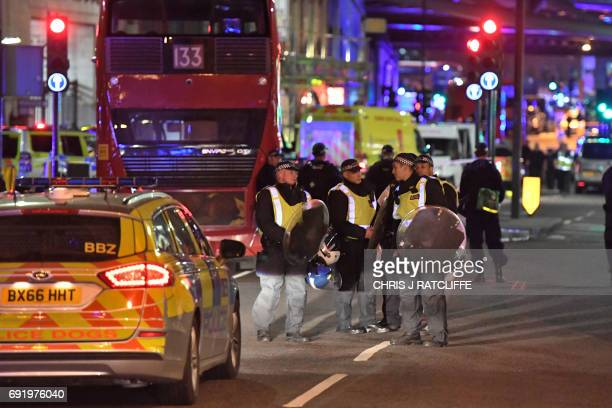 Police patrol at the cordon near London Bridge near the scene of a terror attack in central London on June 3 2017 Armed police fired shots after...