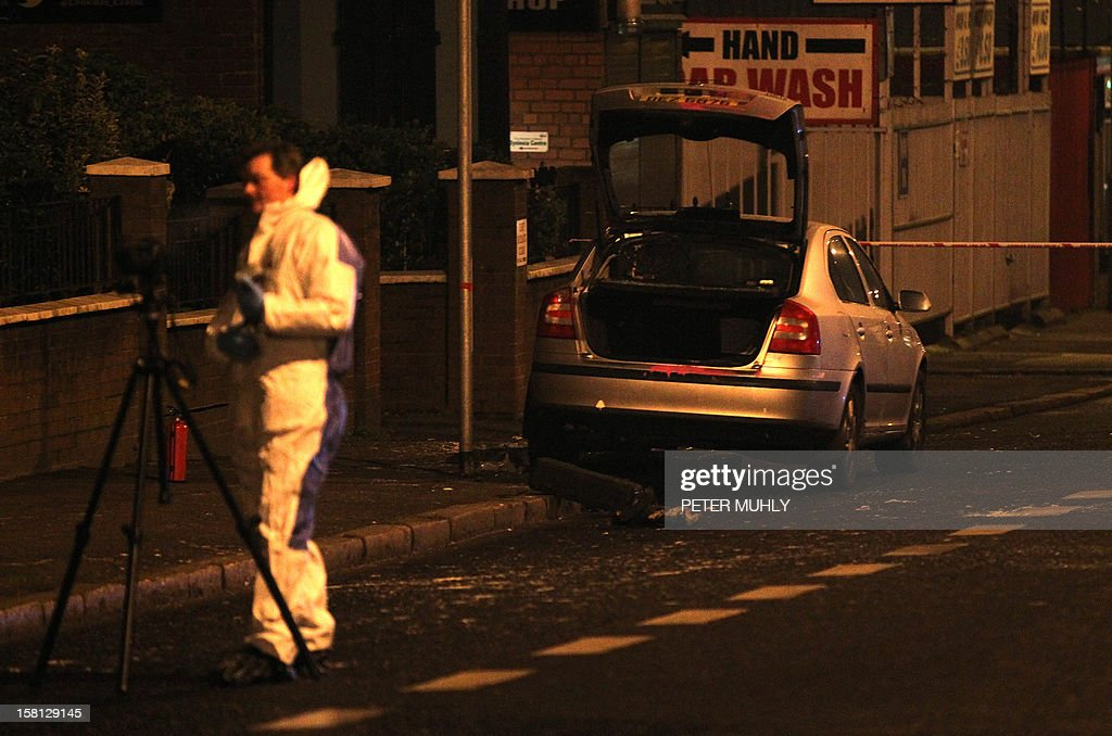 A police patrol car sits burnt outside Alliance Party MP Naomi Long's office in east Belfast, Northern Ireland on December 10, 2012 after being attacked by a masked gang of men with a petrol bomb. The windows of the patrol car were smashed and a petrol bomb thrown in while an officer was still inside the vehicle outside the offices of east Belfast lawmaker Naomi Long, a member of the non-sectarian Alliance Party who has been warned her life is under threat. Police said they were treating the attack as attempted murder in the latest violence to flare up in Northern Ireland over a decision by the city's council not to fly the British flag all year round.