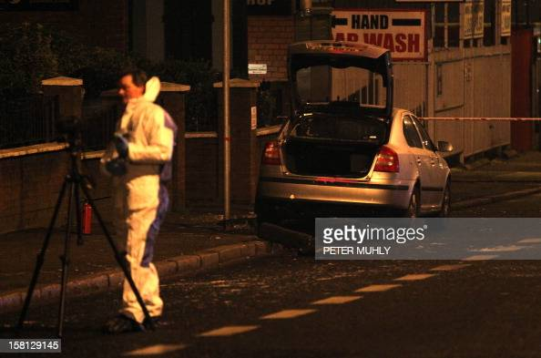 A police patrol car sits burnt outside Alliance Party MP Naomi Long's office in east Belfast Northern Ireland on December 10 2012 after being...