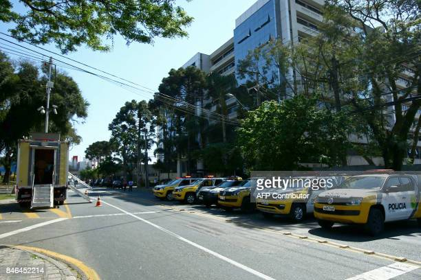 Police patrol cars stand by as supporters of former Brazilian President Luiz Inacio Lula da Silva wait for his arrival at tha Federal Justice office...