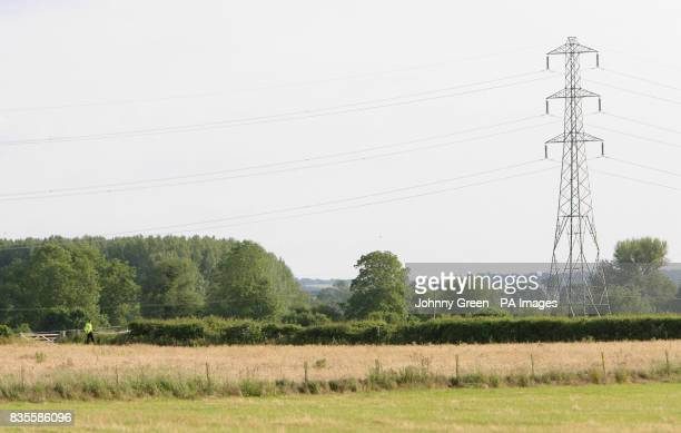 Police patrol fields in Sutton Courtenay near Abingdon in Oxfordshire where two people were today killed in a midair crash today when their RAF...