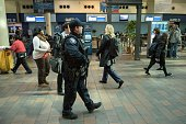 Police patrol in Union Station March 22 2016 in Washington DC New York and Washington DC stepped up security in the wake of the attacks in Brussels...