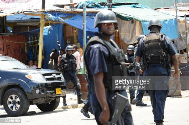 Police patrol on May 24 2010 in Kingston Jamaica after two police officers were killed after coming under attack amid spreading unrest despite a...