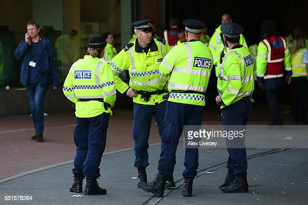 Police patrol outside after the game was abandoned with fans evacuated from the ground prior to the Barclays Premier League match between Manchester...