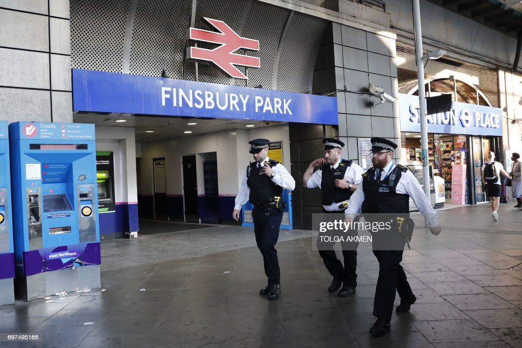 Police patrol outside Finsbury Park station in north London after a vehichle hit pedestrians, on June 19, 2017. A van ploughed into pedestrians near a London mosque in early Monday, killing one man and injuring eight other people in what Prime Minister Theresa May said was 'a potential terrorist attack'. / AFP PHOTO / Tolga AKMEN