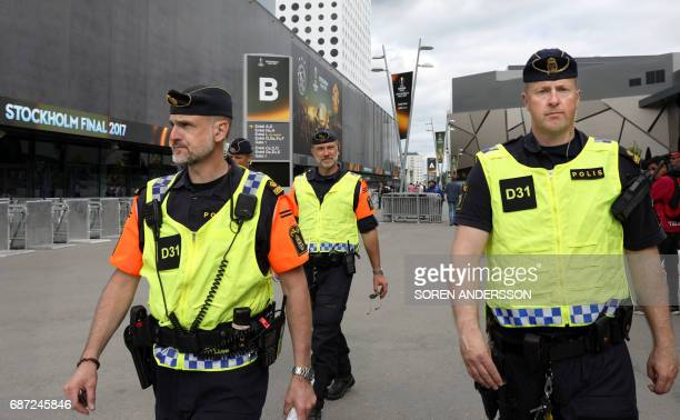 Police patrol outside the Friends arena in Solna outside Stockholm on May 23 on the eve of the UEFA Europa League football final between Ajax and...