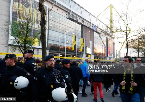 Police patrol outside the stadium after the team bus of Borussia Dortmund had some windows broken by an explosion some 10km away from the stadium...