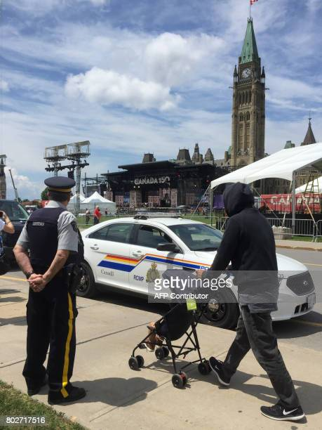Police patrol Parliament Hill in Ottawa on June 28 as Canadian prepare to celebrate the 150th anniversary of confederation Security has been beefed...