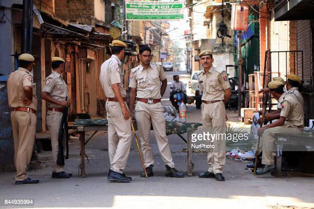 Police patrol streets as curfew was imposed in parts of Jaipur after latenight violence between locals and police triggered by an alleged assault on...