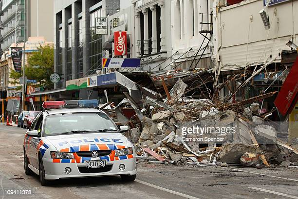 Police patrol streets in the cordoned off zone in the city centre on February 25 2011 in Christchurch New Zealand The death toll has risen to 113 and...