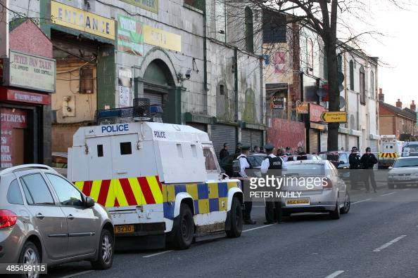 Police patrol the area on the Springfield Road where prominent dissident republicanTommy Crossan was shot dead in West Belfast Northern Ireland on...