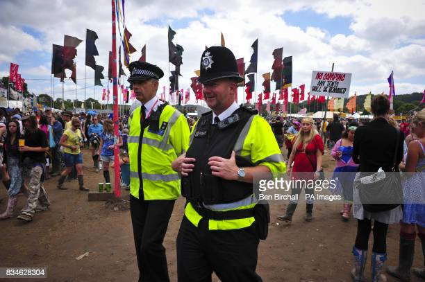 Police patrol the area surrounding the Jazz World stage at Glastonbury festival during day two of the Glastonbury Festival Somerset