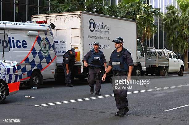 Police patrol the exclusion zone around Philip Street on December 15 2014 in Sydney Australia Police attend a hostage situation at Lindt Cafe in...