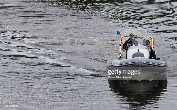Police patrol the River Erne near the location of the G8 summit on June 16 2013 in Enniskillen Northern Ireland The G8 group of world leaders will...