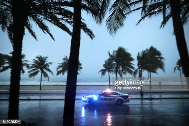 Police patrol the street running along Sebastian Street Beach ahead of the arrival of Hurricane Irma September 9 2017 in Fort Lauderdale Florida...