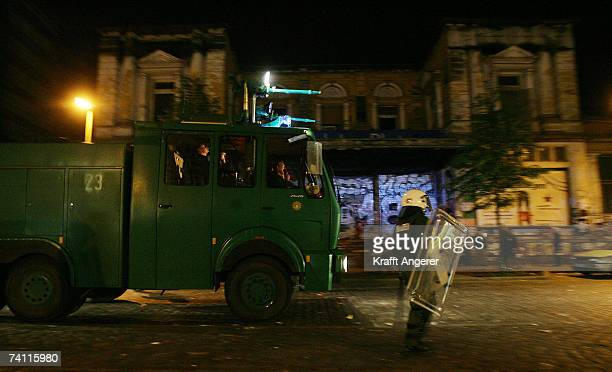 Police patrol the street with a water cannon in front of the 'Rote Flora' a stronghold of G8 opponents on May 9 2007 in Hamburg Germany Police raided...