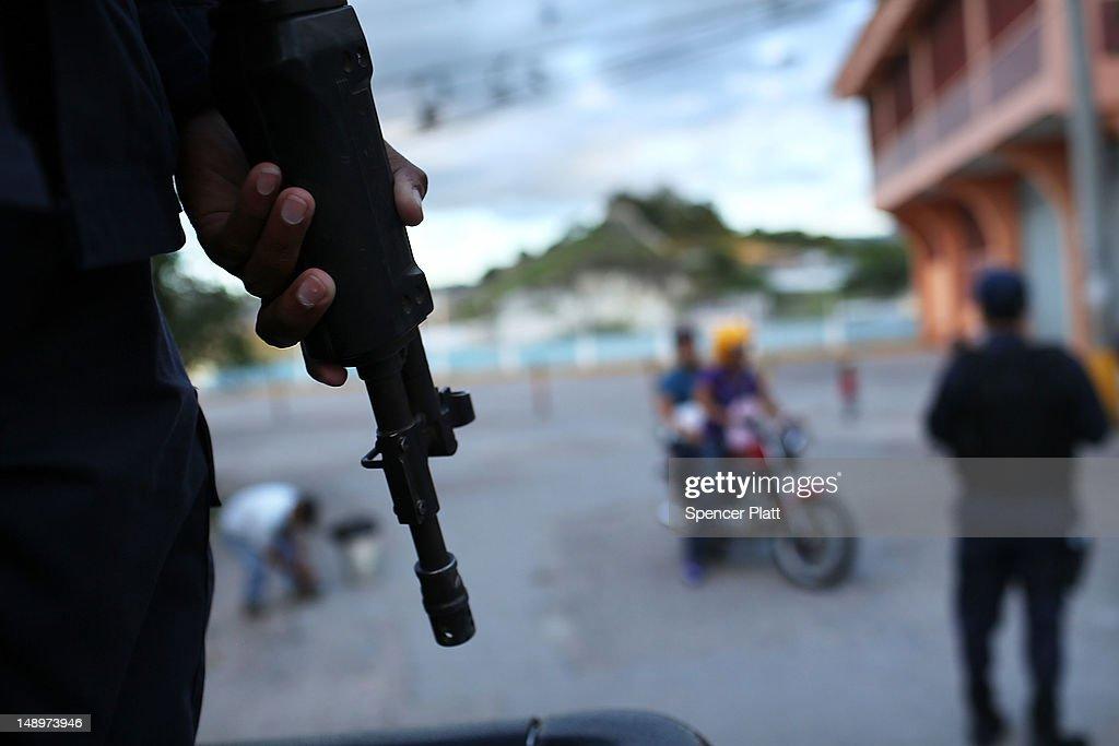 Police patrol the streets of a gang ridden neighborhood on July 20 2012 in Tegucigalpa Honduras Honduras now has the highest per capita murder rate...