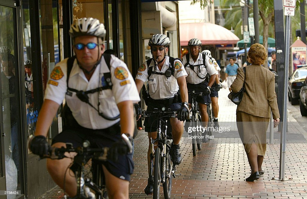 Police patrol the streets on bike on the first day of the 2003 round of ministerial negotiations for the Free Trade Area of the Americas (FTAA) November 17, 2003 in Miami, Florida. Due to expected protests from anarchists, labor groups and globalization foes, much of the city of Miami is in a police lockdown.