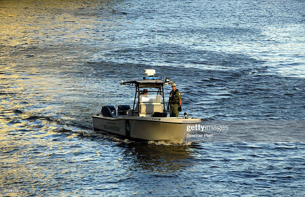 Police patrol the waters on the first day of the 2003 round of ministerial negotiations for the Free Trade Area of the Americas (FTAA) November 17, 2003 in Miami, Florida. Due to expected protests from anarchists, labor groups and globalization foes, much of the city of Miami is in a police lockdown.