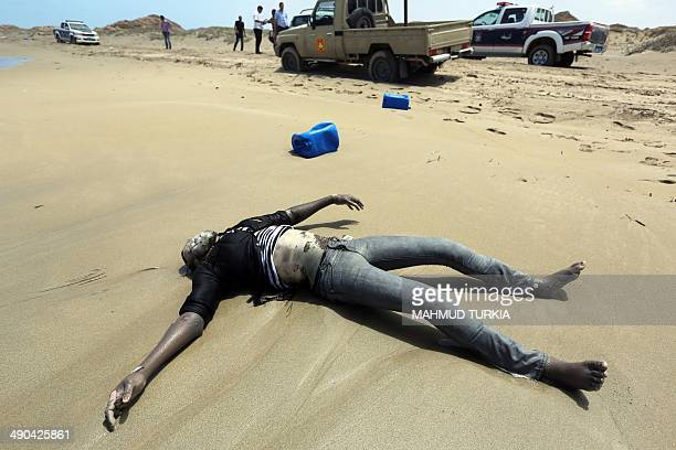 CONTENT A police patrol vehicle is parked close to a body washed up on the shores of alQarbole some 60 kilometers east of the Libyan capital Tripoli...