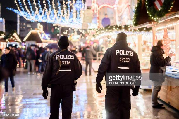 Police patrols at the reopened Christmas market near the KaiserWilhelmGedaechtniskirche in Berlin on December 22 2016 The Berlin Christmas market...