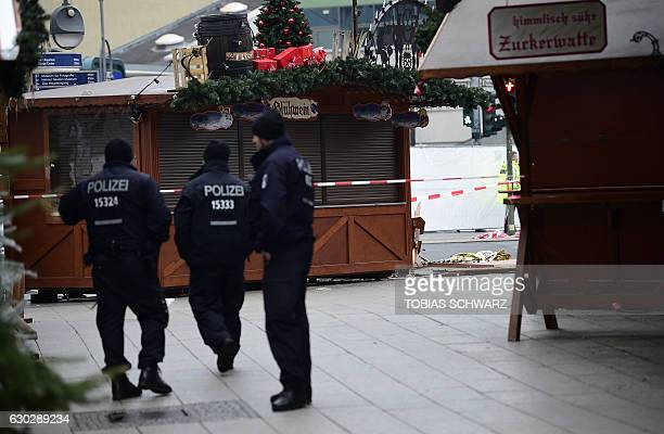 Police patrols the area near Christmas market naer the KaiserWilhelmGedaechtniskirche the day after a terror attack in central Berlin on December 20...