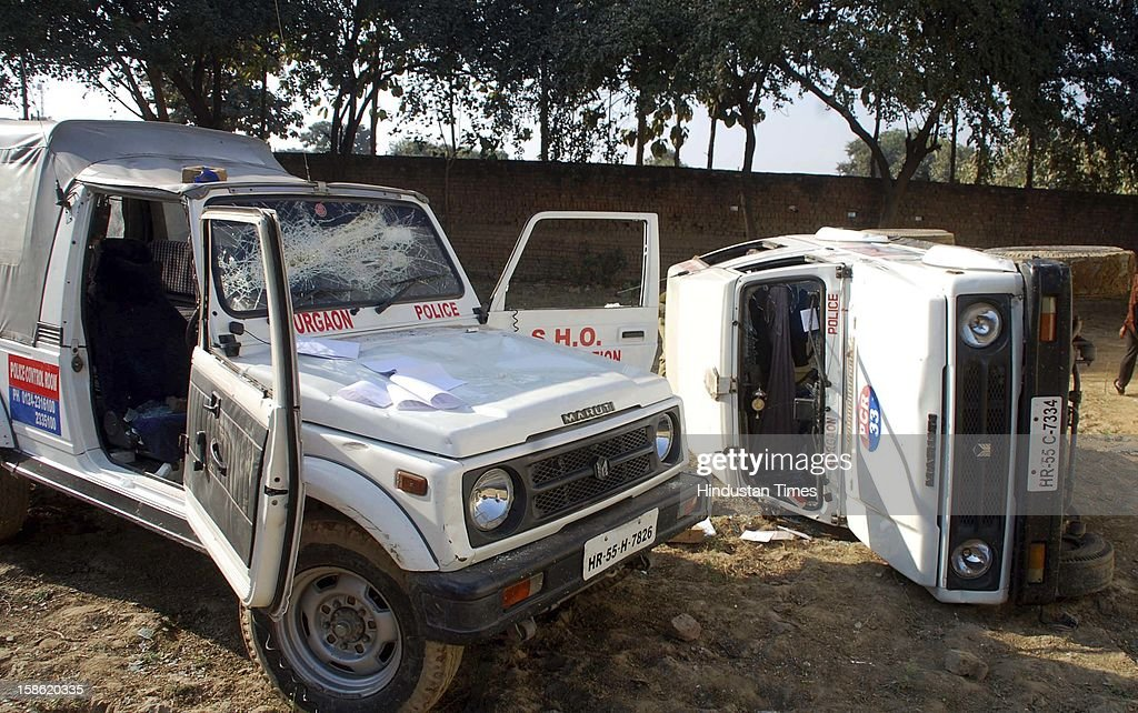 Police PCR vans damaged during clash between residents of Sheetla Colony and police while demolition of illegal construction by administration on December 21, 2012 in Gurgaon, India. Police has arrested some people in the case.