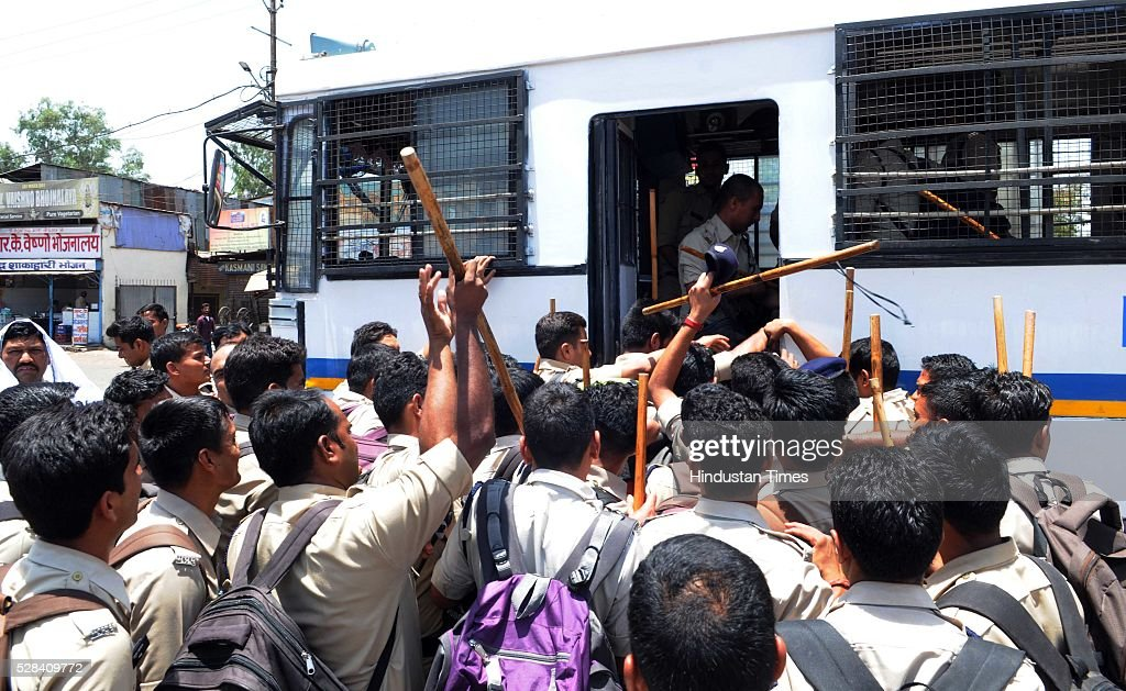 Police personnel boarding a police bus to serve their duty in Simhastha Kumbh Mela in Ujjain, Madhya Pradesh, as they are waiting for the special train which is being run between Bhopal and Ujjain, on May 4, 2016 in Bhopal, India. The month-long Simhastha Kumbh Mela, largest congregation of Hindus began in Ujjain with the arrival of Juna Akhara for the royal bath on the banks of Kshipra river for the holy dip. A large number of people from different corners of the country have converged in the holy city for the Simhastha Mela, held every 12 years at Ujjain, which is also the abode of Lord Mahakaleshwar, one of the 12 Jyotirlings in the country.