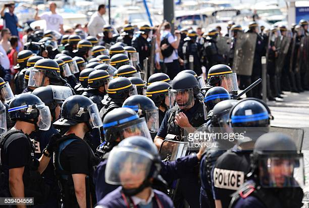 Police personnel in riot gear mass following clashes with England fans in the city of Marseille southern France on June 11 ahead of the Euro 2016...