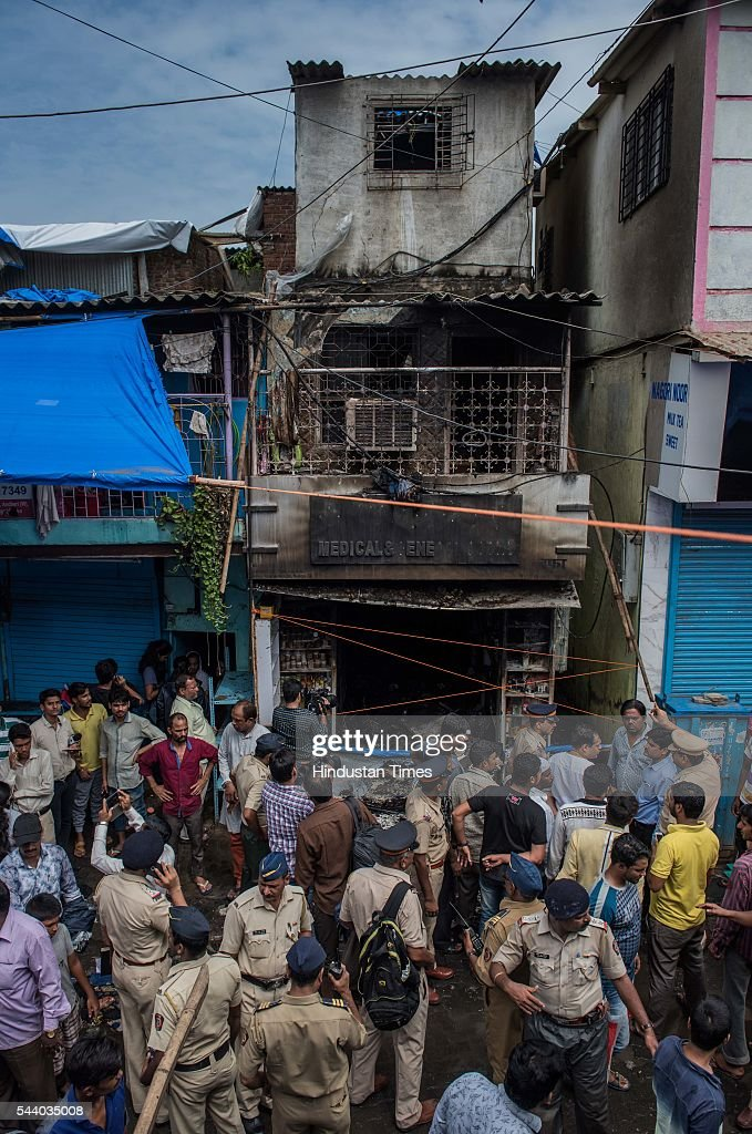 Police personnel inspect the fire spot, which broke early morning 6 am at the 40-year-old Wafa medical store located on the ground floor of the Mestri Chawl at Juhu on June 30, 2016 in Mumbai, India. In a major incident that has shaken up the civic administration, nine people including five children and a pregnant woman, were killed when a fire caused by suspected short circuit broke out in a medical store.