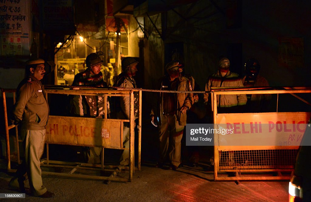 Police personnel stand guard in New Delhi in wee hours on Sunday.