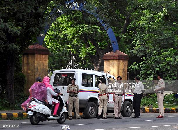 Police personnel stand on vigil outside the Nagpur Central Jail where 1993 Mumbai blasts convict Yakub Memon was executed amidst tight security on...