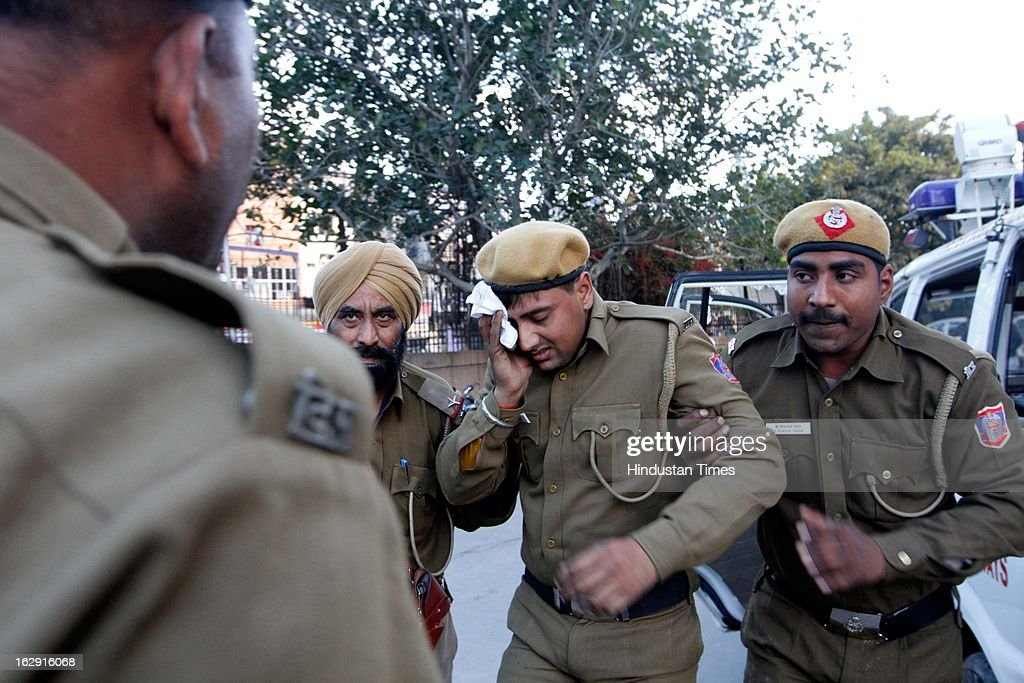 A police personnel who got injured in stone pelting at Sanjay Gandhi hospital during a protest after an eight-year-old girl, student of Class 2, was allegedly raped inside the premises of a North Delhi Municipal Corporation school at Mangolpuri Area on March 1, 2013 in New Delhi, India.